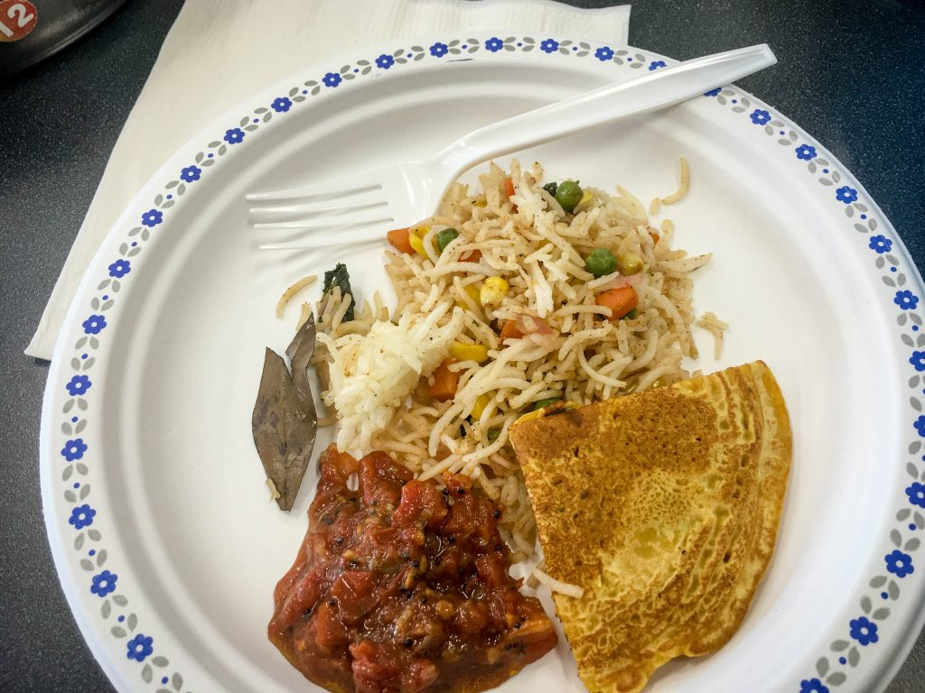 A plate of samples which includes the palao, crepe and chutney